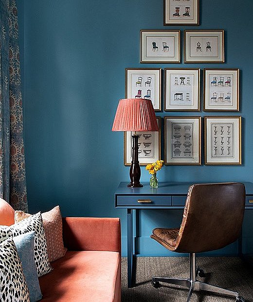Vintage furniture prints were sourced by the client. Moody blue paint gave the office a jewel-box effect, fostering a cozy and contemplative atmosphere.