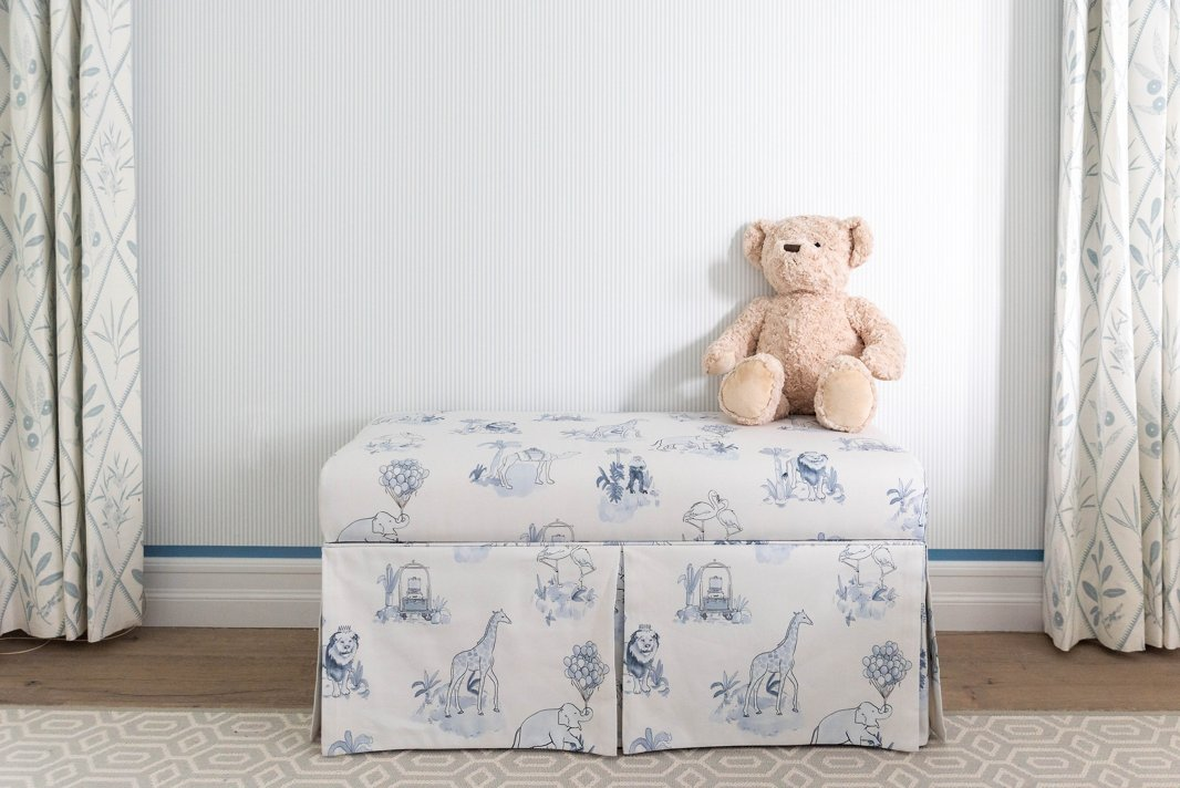 "The Malin Toile print, seen here in blue on a storage bench (it also comes in pink), is a favorite of Gray's. ""It feels both elevated and playful and is very much the vibe of my twins' nurseries,"" he says."