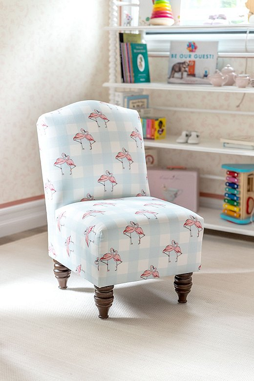 With its pastel check pattern, the Flamingo Gingham Kid's Chair, which Gray used in his twins' playroom, is the ultimate in preppy chic.