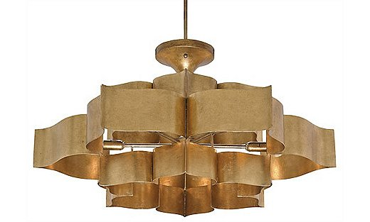 The Grand Lotus Large Chandelier in antique gold leaf; it's also available in black.