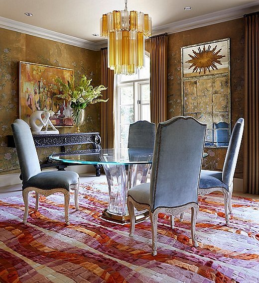 """I love the de Gournay wallpaper but wanted to make it feel fresh and chic,"" says Dennis. He paired it with a graphic rug, punchy art, and a Lucite table. ""The more-traditional pieces like the antique Anglo-Indian console and the Italian wall brackets help the space not to become glam,"" he says."