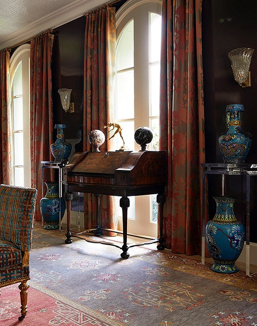 The formal sitting area is a mélange of texture and style. The traditional secretary pairs seamlessly with the large-scale chinoiserie vases.