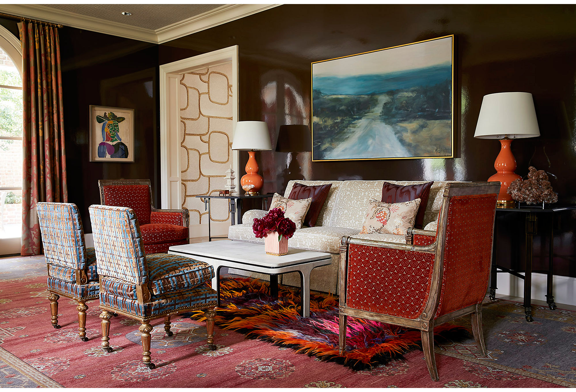 Dennis's choice to mix eras and styles keeps the room interesting at every turn. Layering a wild shag carpet over an Oriental rug exemplifies his maximalist nature.