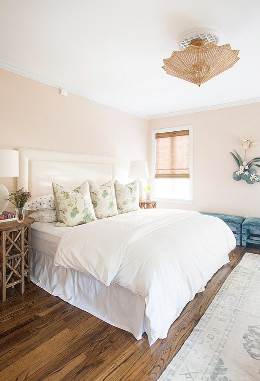 Courtland first saw this color scheme in a friend's house and had to try it. She paired the blush walls with natural elements,such as the rattan Celerie Kemble for Arteriorsceiling fixture.