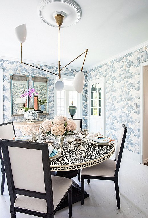 Courtland fell in love with Scalamandré's Raphael wallpaper and knew she had to put it somewhere special. The paper takes inspiration from the leafy treetops of New York City's Central Park and antique tapestries.