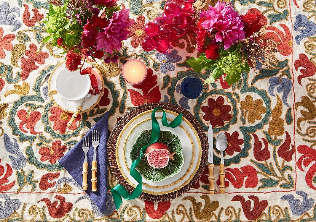 Flatware, dishes, cup, and saucer, Juliska Bamboo; napkin, Mode Living Fiji in Sea Blue.