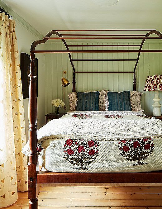 Heide paired delightful block-print accents with this antique canopy bed.