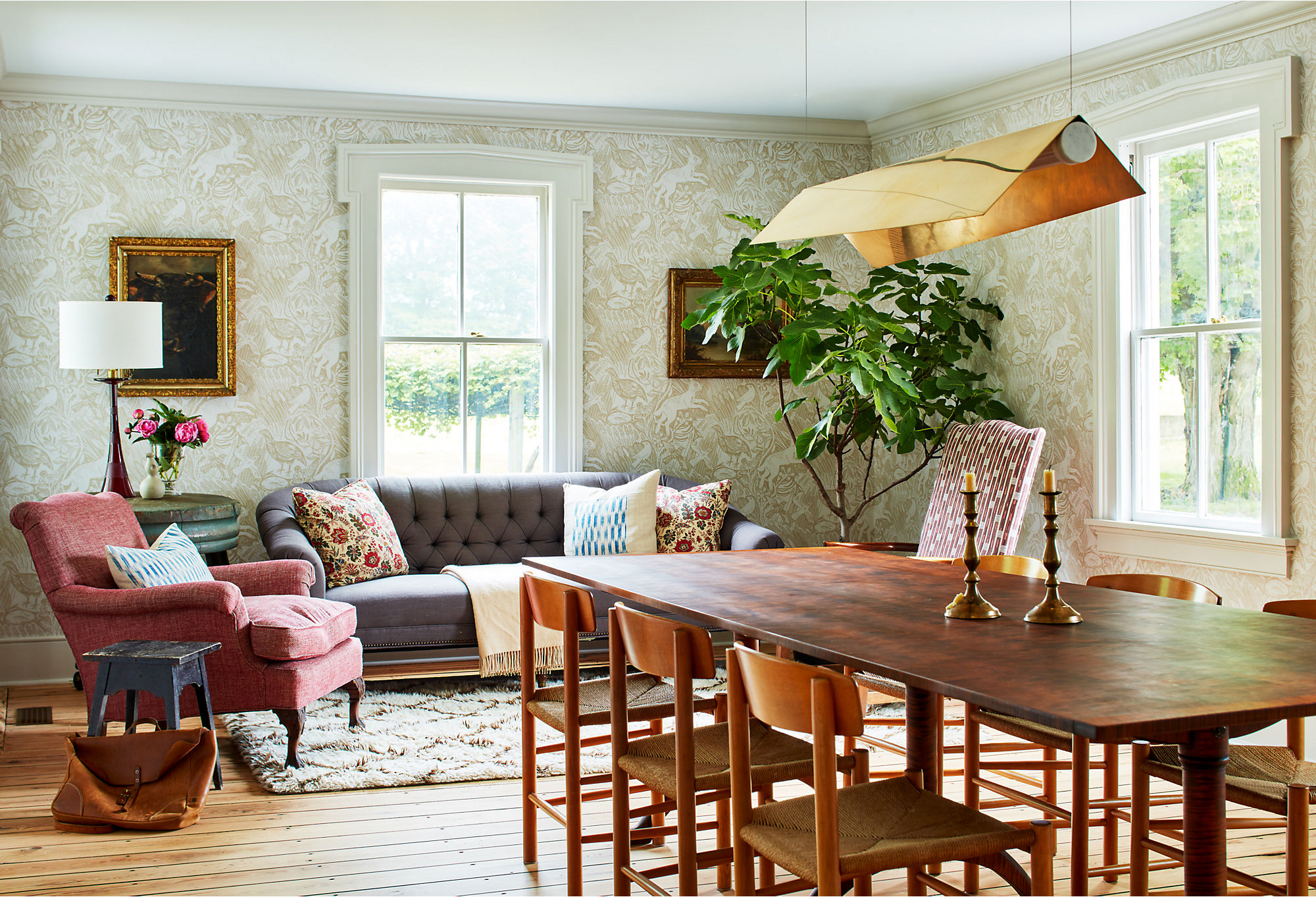 """The dining room sits in the middle of the house. Heide wanted the heavily trafficked space to have multiple functions. The sitting portion of the dining room gets amazing light that """"makes this area especially wonderful for reading and a morning cup of coffee,"""" she says. """"Likewise, the area functions as a spillover lounge area during long dinner parties."""""""