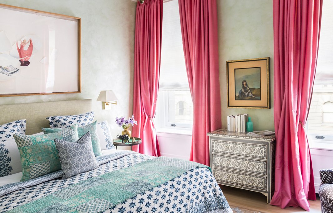 "Velvety Venetian-plaster walls give the master bedroom a sense of serenity. ""You don't want something too unharmonious in your bedroom—you don't want something that doesn't calm you,"" Roberta says. One bold stroke: the magenta silk curtains, another part of her haul from the Bangkok market."