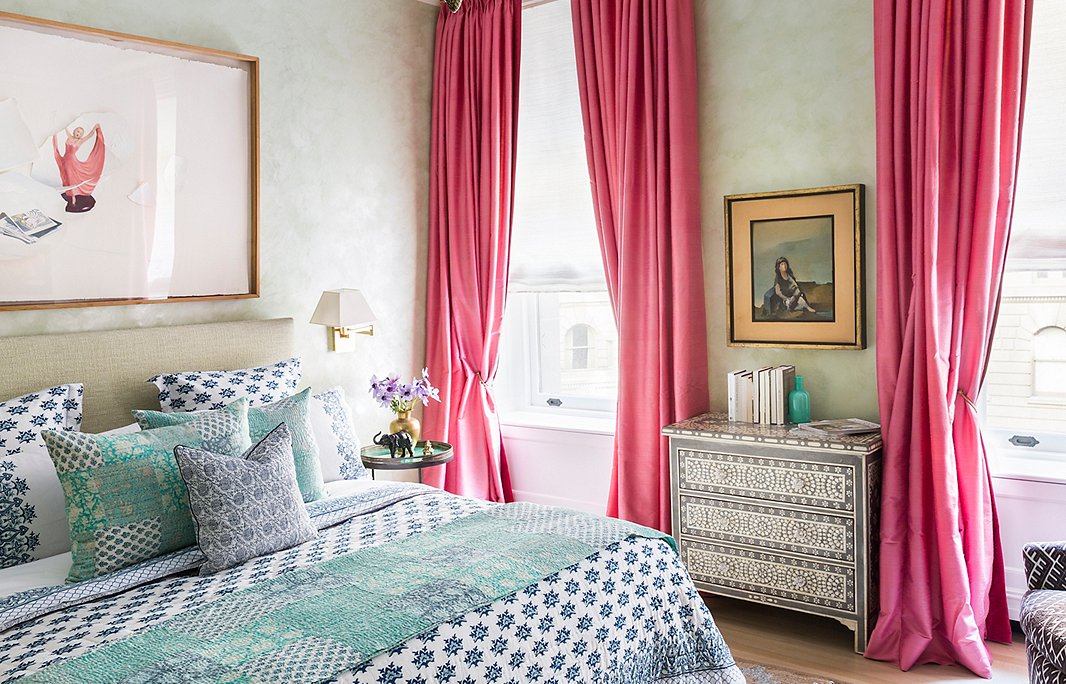A profusion of patterns (including Roller Rabbit bedding) and splashes of color give this bedroom its Eclectic panache. Photo by Lesley Unruh.
