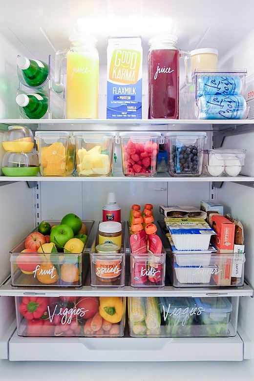 Clear—and clearly labeled—plastic bins ensure you can easily see everything in your fridge (no forgotten leftovers here!).