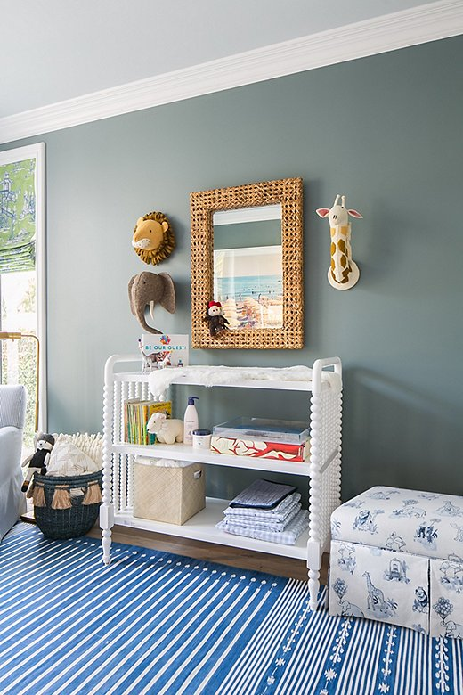 The Malin Toile Storage Bench, seen here in Gray's son's room, provides a soft spot to sit and a sneaky space to stow away blankets and toys.