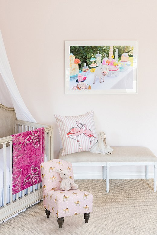 The Flamingo Stripe Pillow and the kid-size Camel Dot Chair (both shown in pink) make a sweet pairing in Gray's daughter's room.