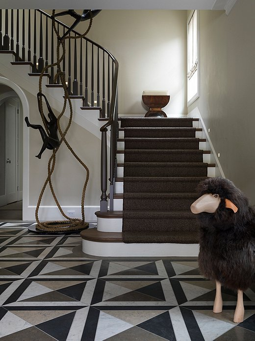 The homeowners found this towering bronze statue by Israeli artist Tolla Inbar while vacationing.  Heather paired it with a sheep to make a whimsical statement in the foyer.