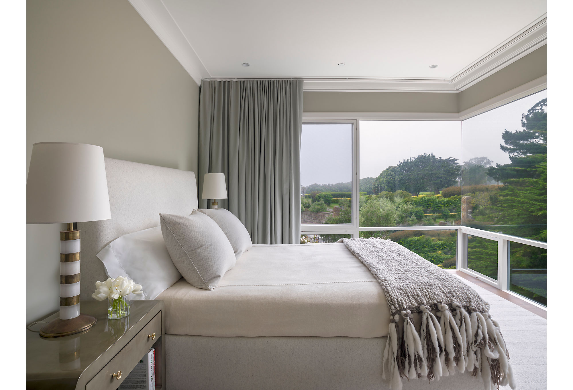 The master bedroom, painted a light celadon, is devoid of art or many accessories because the homeowners didn't want to distract from the view. On clear days, they can even see the Golden Gate bridge.