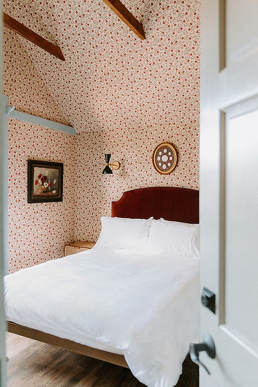 The use of wallpaper in this room accentuates the unique architecture of the hotel.