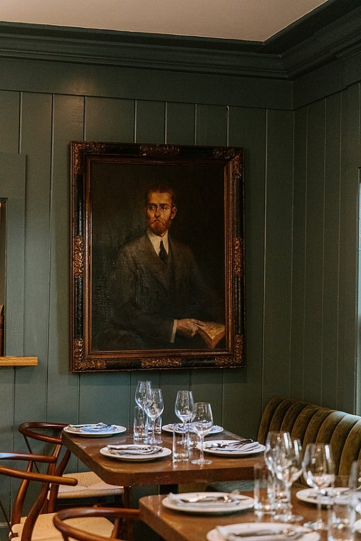 All the antique portraits that hang throughout the hotel are pieces in the narrative puzzle of Jason's design.