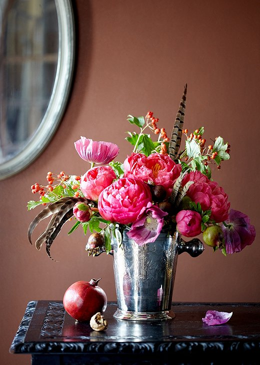 If you manage to score peonies in their off-season, try pairing them with pomegranates, wild poppies, serviceberries, and pheasant feathers for a fall-feeling look. Arrangement by Meghan Guthrie.