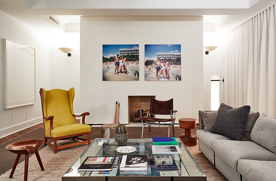 Designer Timothy Brown's approach was simple: to design a room he could imagine himself living in. The handsome space features an L-shape sofa from the 1970s, a glass coffee table layered with books, and a wingback chair upholstered in a shade just shy of chartreuse. Anchored by two layered rugs, the room reads like a sophisticated take on the conversation pits of yesteryear.