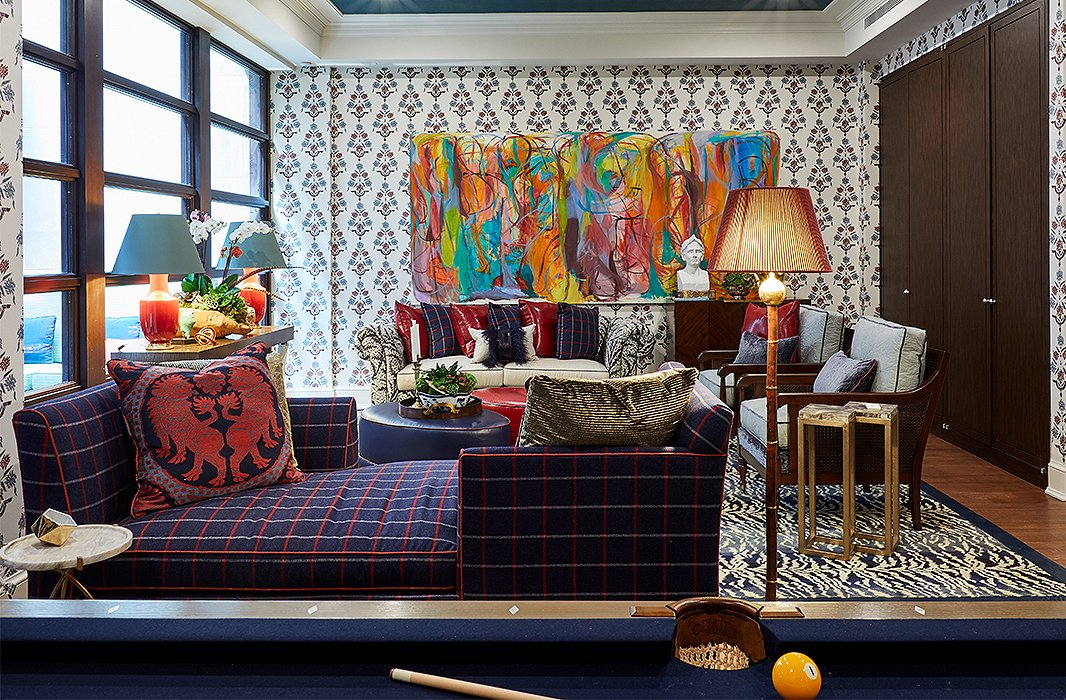 Chock-full of wild touches such as a chesterfield sofa covered in a snakeskin print, a zebra rug, and a console with tusks for legs, Eric Haydel's game room leans toward the wilder side of things. The playful vibe belies the room's functionality: A plethora of seating options, plus ottomans that double as cocktail tables, make this a versatile entertaining space.