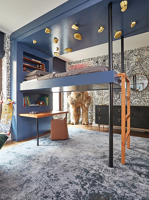Gabriel and Brooke Anderson of Dean & Dahl dreamt up a kids' bedroom primed for fun. Imaginative touches such as a loft bed encased by a climbing wall, a shaggy figure resembling Bigfoot, and a graffiti-style mural by Utah-based artist Carrie Ellen come together to create a space that lifts the spirits of both young and old.