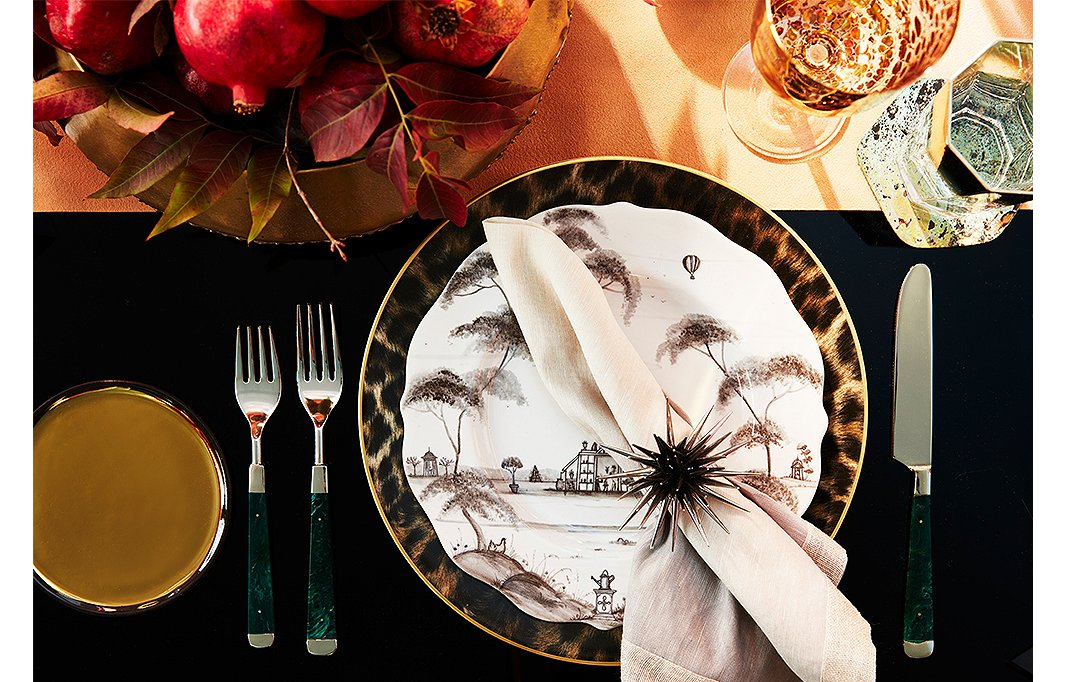 Malachite flatware by Kim Seybert complements plates by Juliska and chargers by Ralph Lauren Home.
