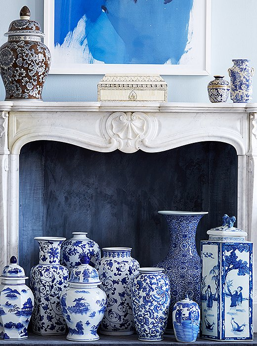 The fireplace is an ideal spot for showing off a collection, such as this medley of blue-and-white ginger jars. With varying heights, shapes, and patterns, they have more impact grouped together than they would scattered throughout the house. Photo by Manuel Rodriguez