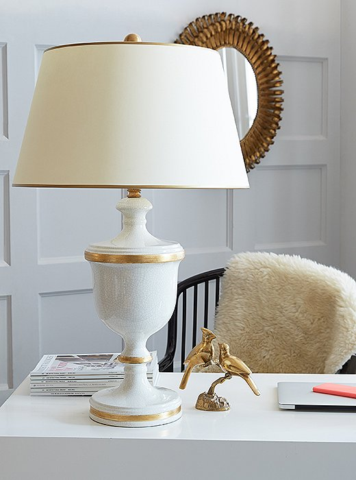 The Pacific Beach Lamp (shown here in gold and white) features a crackled cream glaze and lots of gold (on the body, trimming the shade, and on the finial).