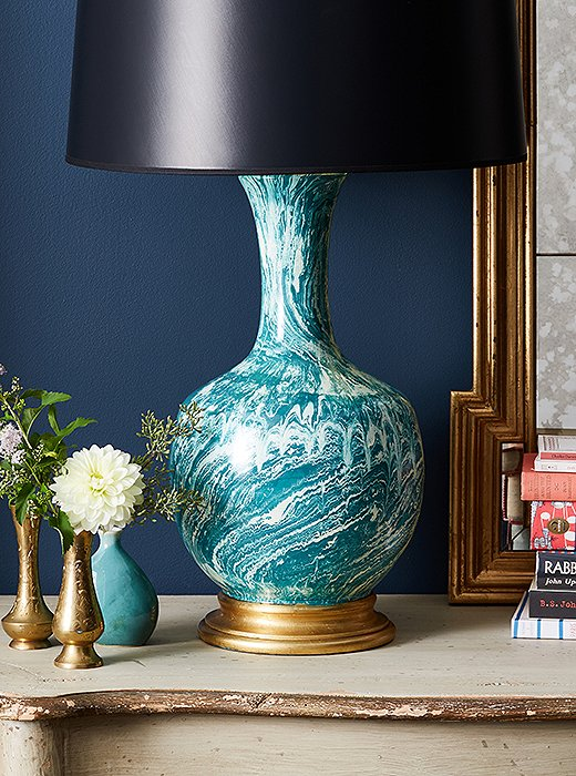 The Astor Couture Table Lamp adds a graphic punch with its eye-catching marbleized pattern.