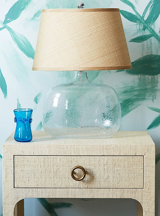 This mahogany nightstand is finished in a layer of woven raffia for a richly tactile look. And paired with a bubble-glass base, a raffia lampshade is the ultimate in beachy chic.