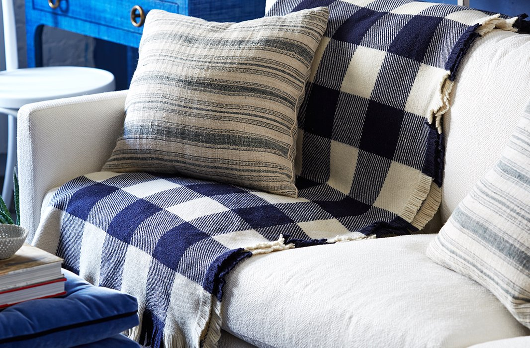 "The navy gingham blanket was the launching point for Ben's design. ""It's a favorite pattern of mine, and the large scale of the print makes it a little more modern."""