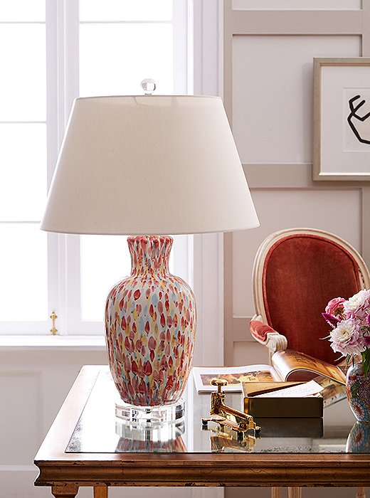 The Pink Petals Table Lamp brings in a bright pop of color and pays subtle homage to floral prints with its petallike pattern.