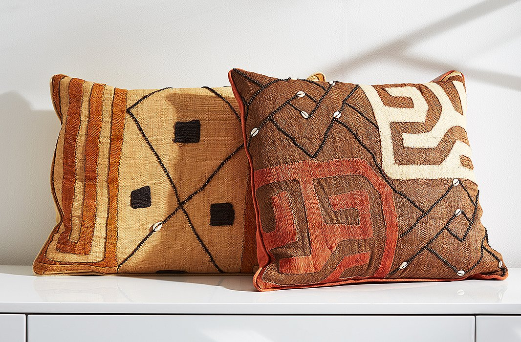 Kuba cloth iswoven from fibers of raffia palms and often embellished with dye, embroidery, beads, and shells.