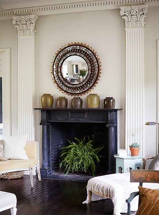 A feathery fern brings fresh life to a dark fireplace—and a jolt of color to an otherwise-neutral room. Photo by Manuel Rodriguez
