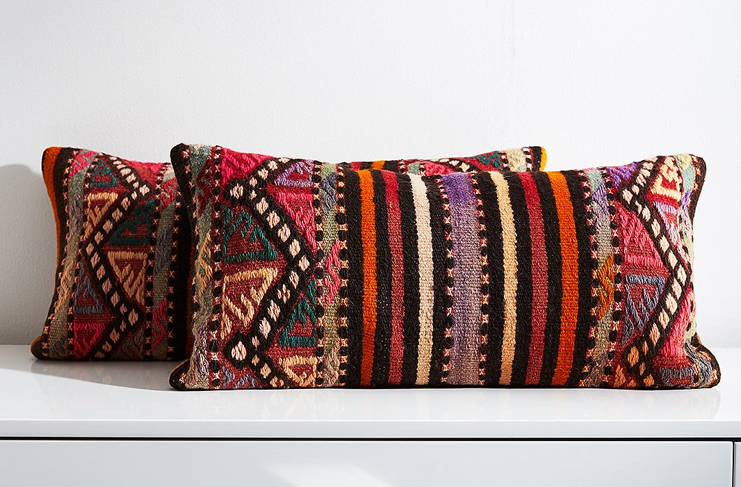 Woven on a loom to create a tight, flat weave, kilim rugs are often turned into upholstery for pillows and other furnishings.