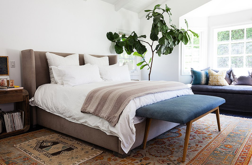 Easy Ways To Master The Layered Rug Look - Rugs for bedrooms