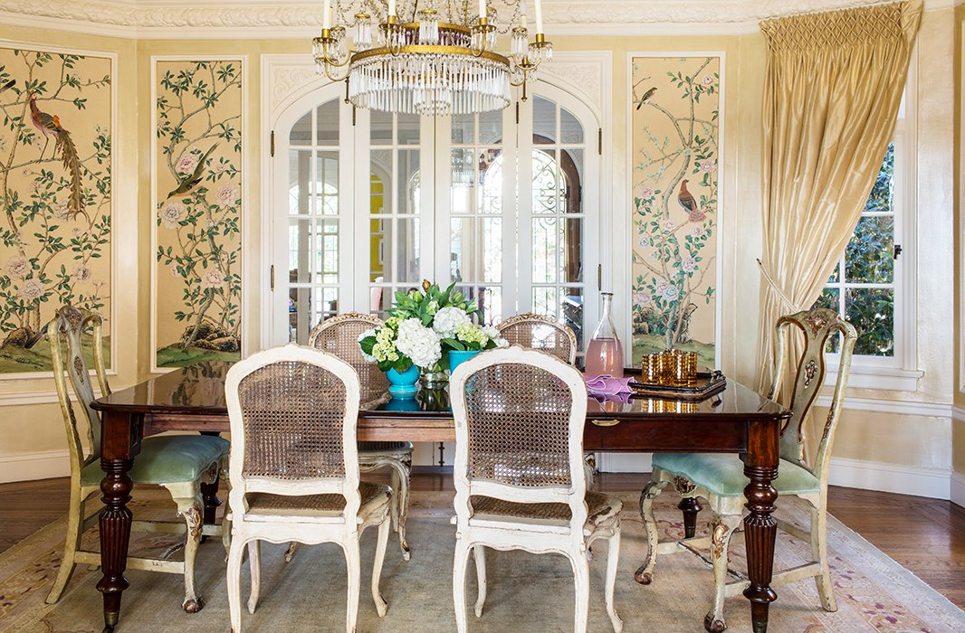 Floral wallpaper panels mimic the elegance of traditional hand-painted silk screens.