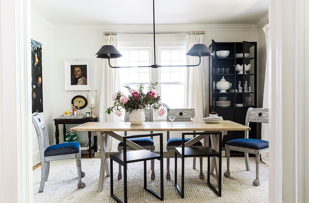 Mismatched chairs take center stage in the dining room of Michelle Adams's Michigan home. Photo by Lesley Unruh
