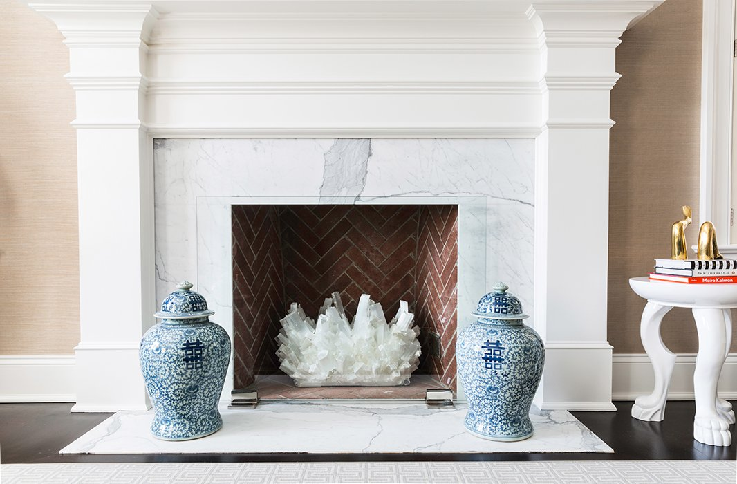 Flanked by a set of blue-and-white ginger jars, a large crystal takes the place of a roaring fire—and gives off nearly the same amount of sparkle. Photo by Lesley Unruh