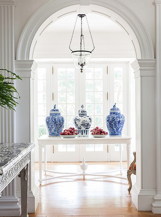 Blue-and-white ginger jars are a decorative staple in today's traditional interiors. Clustered on a mantel or console, they lend a fresh yet timeless look.