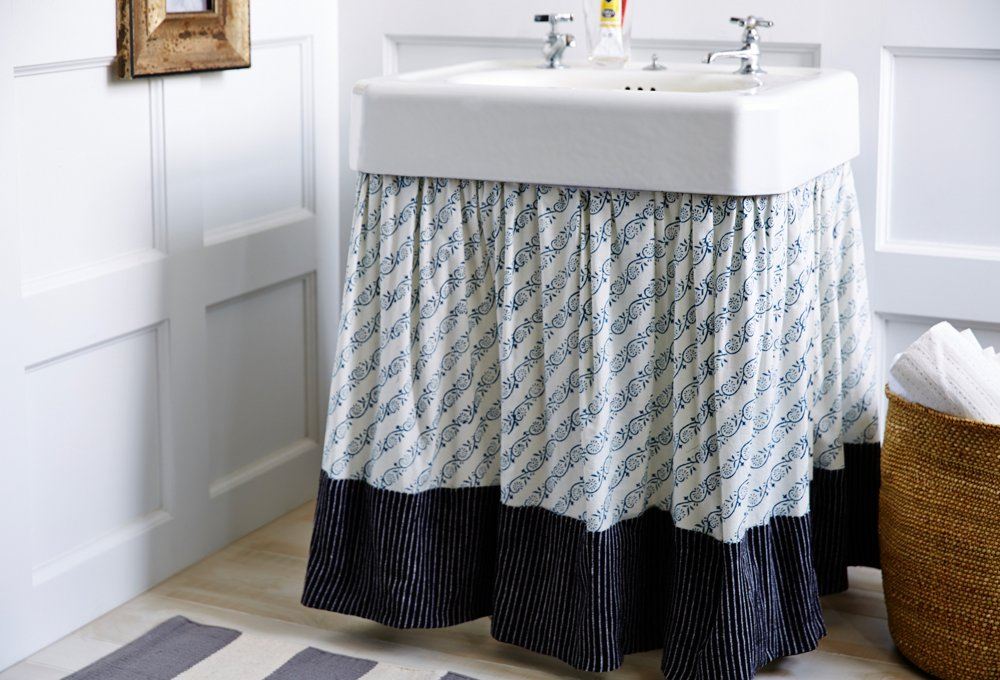 Bathroom storage - Make a skirt for a pedestal sink and then hide a set of rolling drawers underneath.