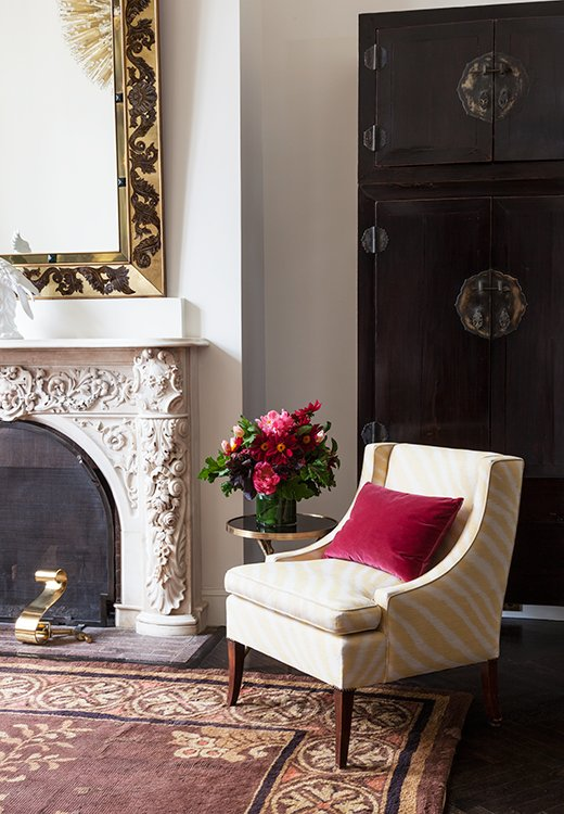 A yellow zebra-print chair is a modern, playful addition to this otherwise traditional corner.