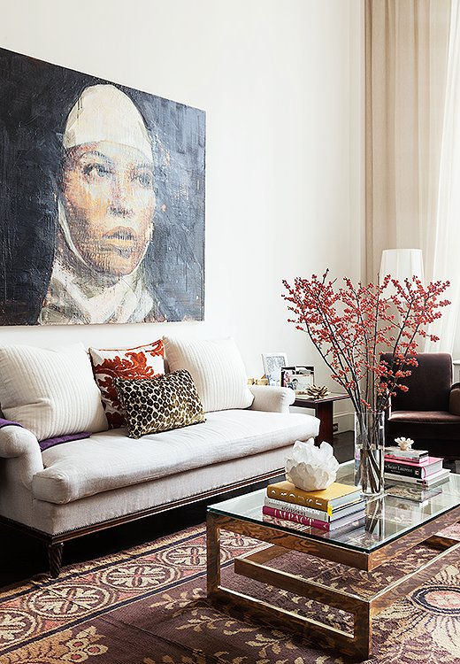 """A view of the sofa and Tony Scherman's Grey Nun, a depiction of French writer Catherine Millet. Smith says, """"It reminds me of Kate Moss!"""""""