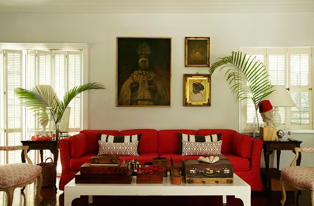 A red slipcover gave new life to India's 45-year-old sofa. Photograph byMiguel Flores-Vianna.