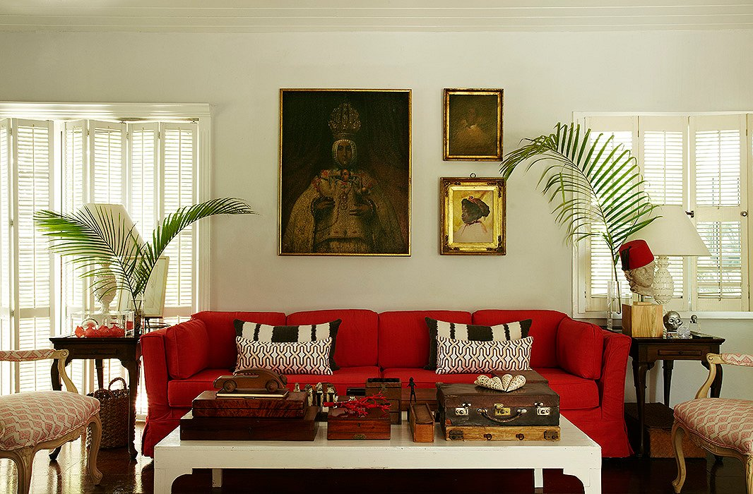 A red slipcover gave new life to India's 45-year-old sofa. Photograph by Miguel Flores-Vianna.