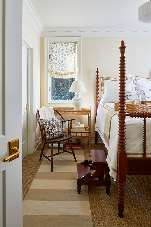 Tone on tone was the key to designingthis bedroom. Antique furniture grounds the space, while whimsical details in the window coverings and layered rugs add interest. The walls are painted in Farrow & Ball's James White.