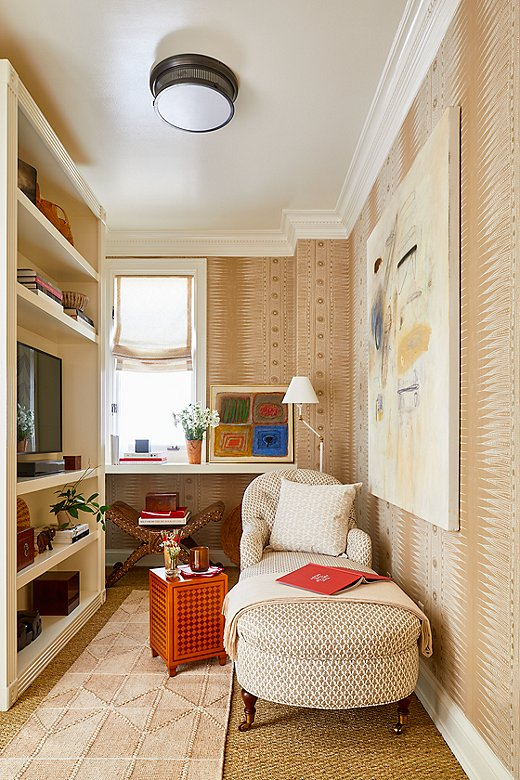 Jeremy transformed thesewing roomof Albert Hadley's sister into a small sitting area. Jeremy installedbuilt-in shelving, added theMarlowe Chaisefrom One Kings Lane, and hung an abstract painting.