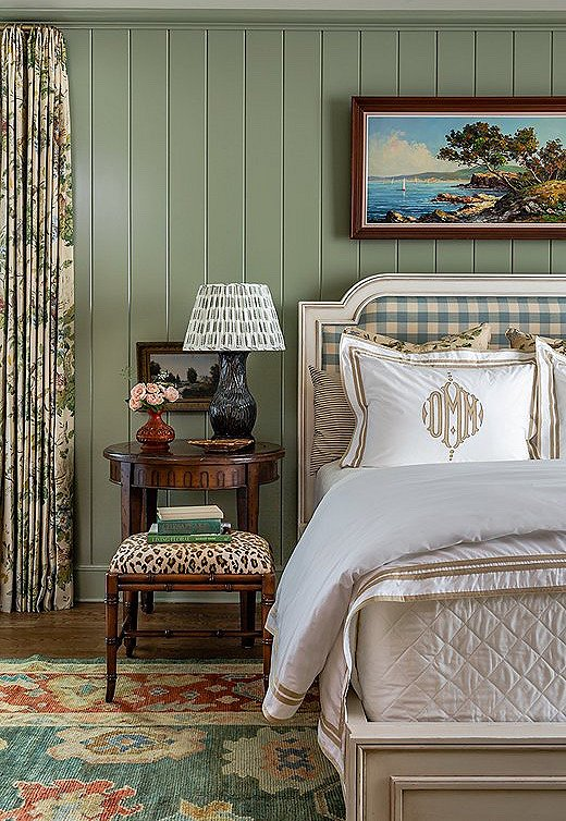 Sage green is the perfect background for a room of neutral colors. A buffalo-check headboard and monogrammed linens are indicative of the home's Southern panache.