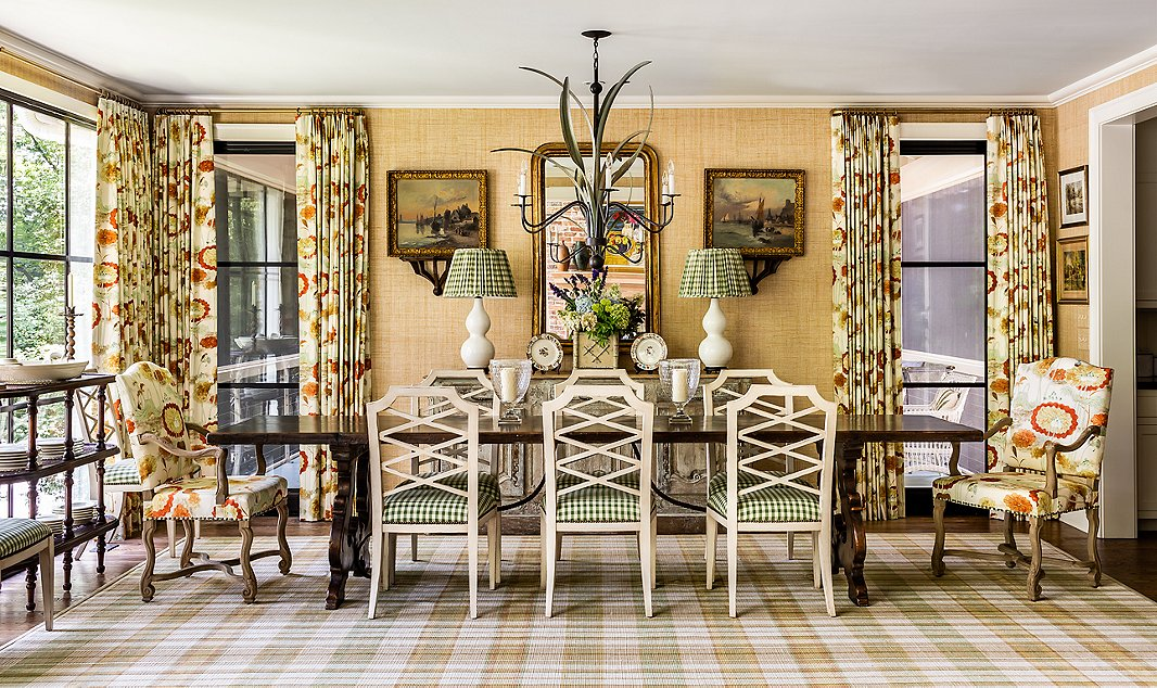 Pattern on pattern is the name of the game in this lakeside home. The plaid rug served as the base for this room. James pulled colors for the upholstery, curtains, and raffia wall covering from the rug's soft tones.