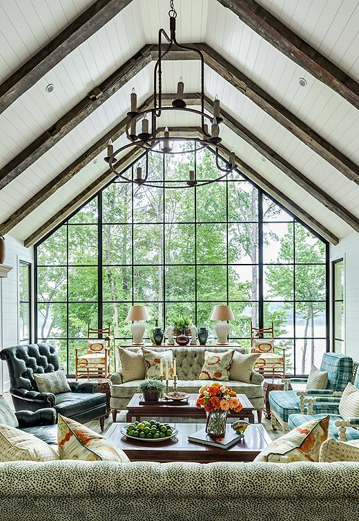 A panoramic view isthe star of this living room. Soft blues and greens reflect the ease of lakeside living and the colors of nature.